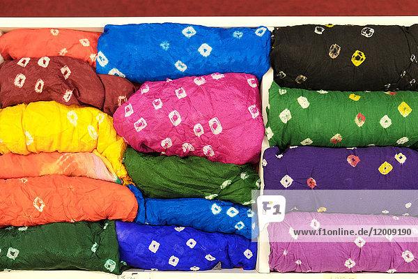 Piles of multicolor fabric