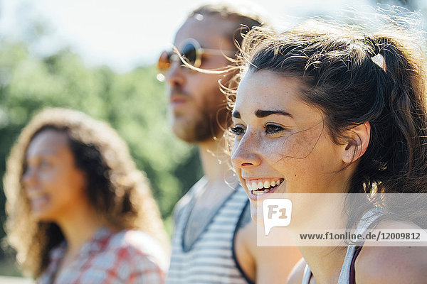 Close up of smiling woman with friends