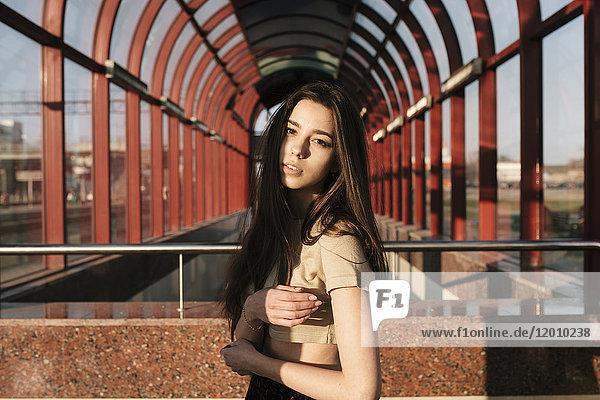 Portrait of Caucasian woman near arches outdoors