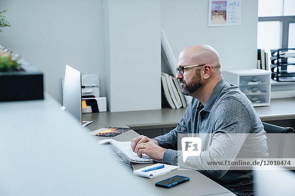 Caucasian businessman using computer
