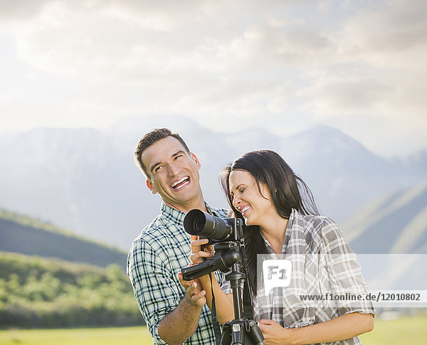 Couple with camera laughing