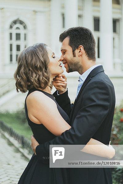Portrait of smiling Caucasian couple kissing
