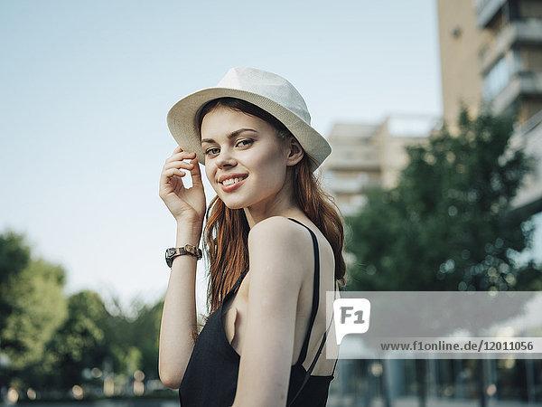 Portrait of smiling Caucasian woman holding hat
