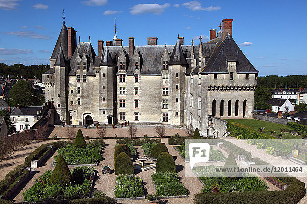 France  Centre France  Touraine  Chateau feodal de Langeais. General view of the inner courtyard with its gardens from the dungeon. Blue sky.
