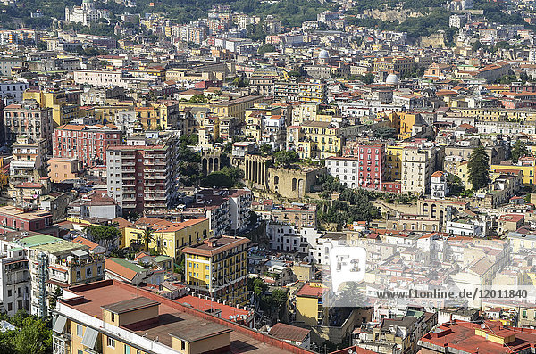 Aerial view over the city of Naples  with historic buildings and rooftops.