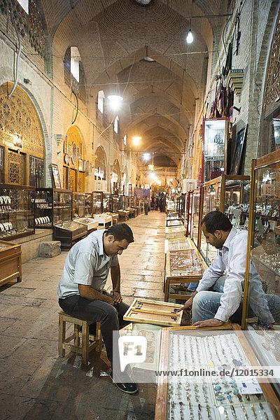 Backgammon players in the Shiraz souk  iran