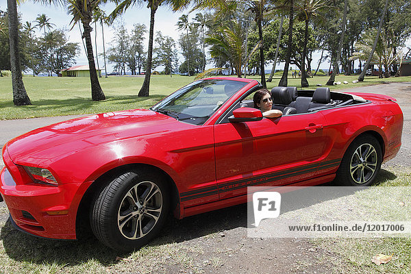 Red Ford Mustang convertible car