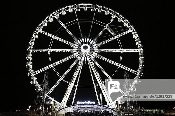 Paris. 8th district. Avenue des Champs Elysees at night. Christmas period. Place de la Concorde. Roue de Paris.