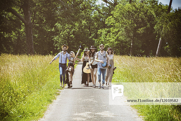 Youth group Hipster face  walking on the country road
