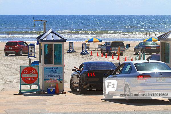 USA  Florida  Daytona Beach.Car on the beach.