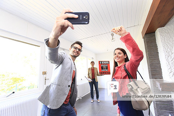 France  young person couples being caught in photograph after having to buy or rent a housing.