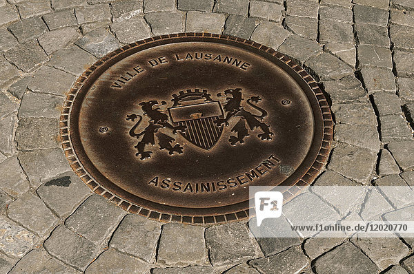 Switzerland  Canton of Vaud  region of Leman  Lausanne  close-up on the pavement and on a sewer drain with he city coats of arms on it in the old town
