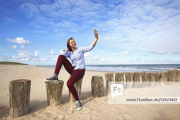France  woman doing selfie.