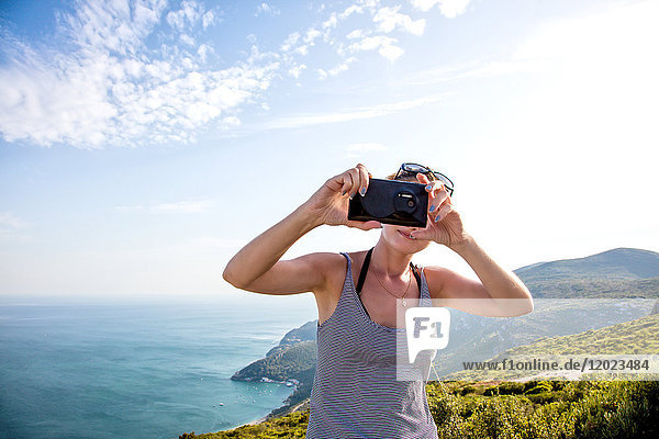 Portrait of a young woman face  taking a selfie with smartphone on the heights of Setubal  Lisbon area  Portugal