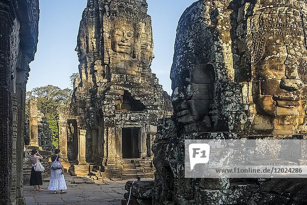 Tourists  in Bayon temple  Angkor Thom  Angkor  Siem Reap  Cambodia.