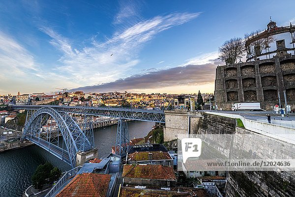 Famous Dom Luis I arch bridge between cities of Porto and Vila Nova de Gaia cities  Portugal. Serra do Pilar Monastery on left.