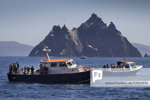 Excursion boats arriving at Great Skellig or also called Skellig Michael. Skellig Islands  County Kerry  Ireland  Europe.