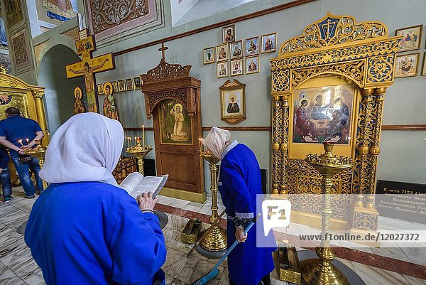 Russia  Kolomna. Woman praying in the interior of the Uspensky cathedral.