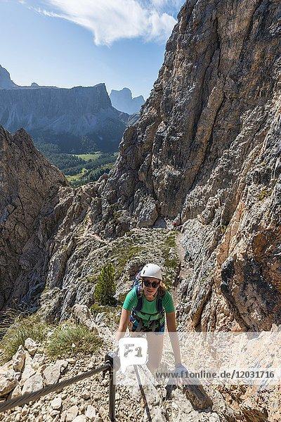 Woman on via ferrata to Nuvolau and Averau  view of Tofane  Dolomites  South Tyrol  Trentino-Alto Adige  Italy  Europe