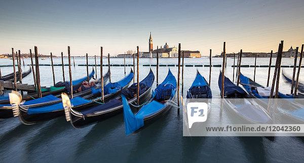 View towards San Giorgio Maggiore from Riva Degli Schiavoni  with gondolas in foreground  Venice  UNESCO World Heritage Site  Veneto  Italy  Europe