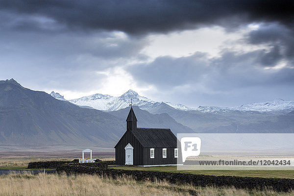 Black wooden church against mountains  Budir  Snaefellsnes Peninsula  Iceland  Polar Regions