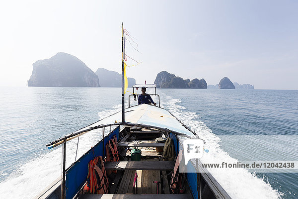 Traditional longtail boat with the Koh Hong Islands in the background  Krabi Coast  Krabi  Thailand  Southeast Asia  Asia
