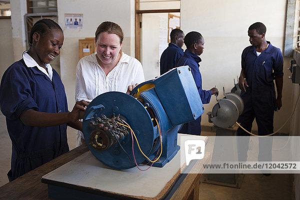 A VSO volunteer teaching a female electrician  Tanzania  East Africa  Africa