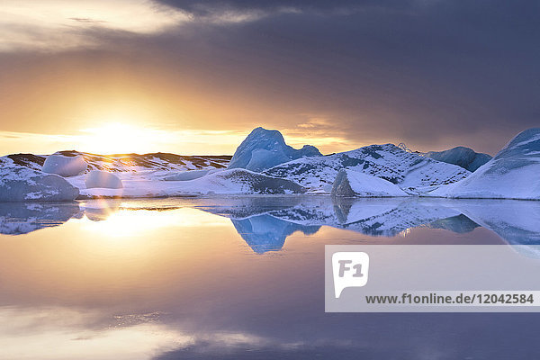 Icebergs covered in dusting of snow  winter  sunset  Jokulsarlon Glacial Lagoon  South Iceland  Polar Regions