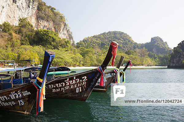 Traditional longtail boats and limestone cliffs  Hong Island  one of the Koh Hong Islands  Ao Nang  Krabi  Thailand  Southeast Asia  Asia