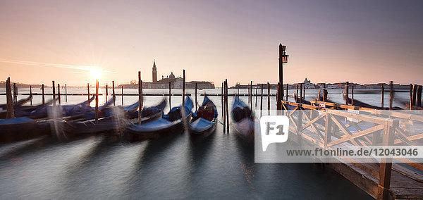 View towards San Giorgio Maggiore at dawn from Riva Degli Schiavoni  with gondolas in foreground  Venice  UNESCO World Heritage Site  Veneto  Italy  Europe