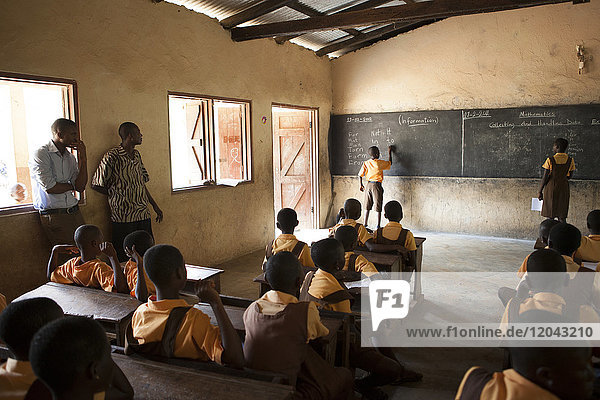 A classroom of school children learning about the potential of cocoa farming  Ghana  West Africa  Africa