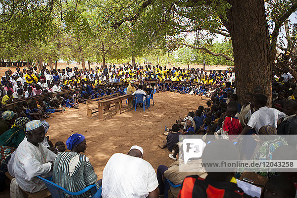 Students at a junior High School watch a play about teenage pregnancy put on by the schools Gender Club  Ghana  West Africa  Africa