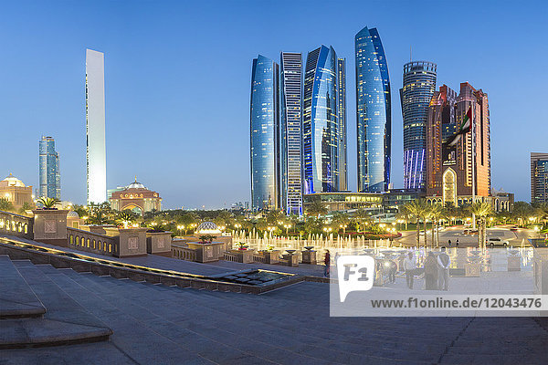 Etihad Towers viewed over the fountains of the Emirates Palace Hotel  Abu Dhabi  United Arab Emirates  Middle East