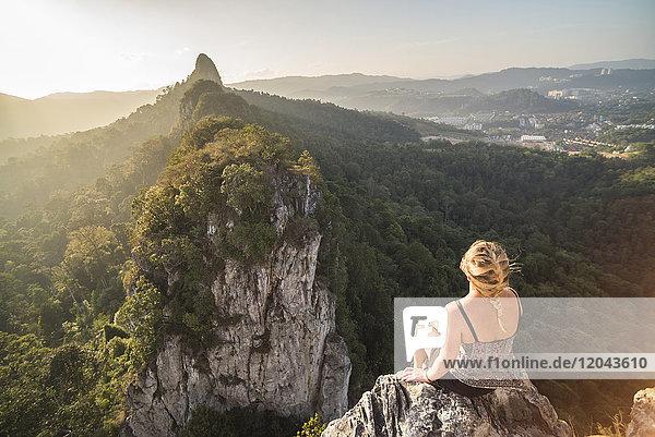 Tourist on Bukit Tabur Mountain at sunrise  Kuala Lumpur  Malaysia  Southeast Asia  Asia