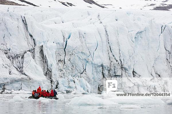 Zodiac trip for tourists  Hornbreen Glacier  Spitsbergen  Svalbard  Arctic  Norway  Europe