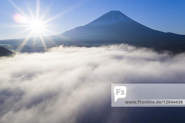 Clouds over Lake Ashinoko with Mount Fuji behind  Fuji-Hakone-Izu National Park  Hakone  Shizuoka  Honshu  Japan  Asia