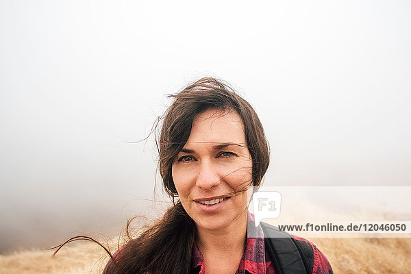 Portrait of woman in misty field looking at camera smiling  Fairfax  California  USA  North America