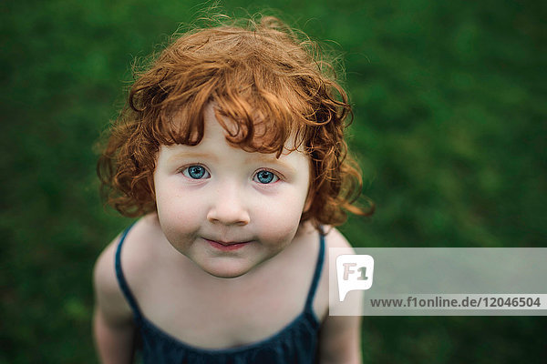 Portrait of toddler with red hair