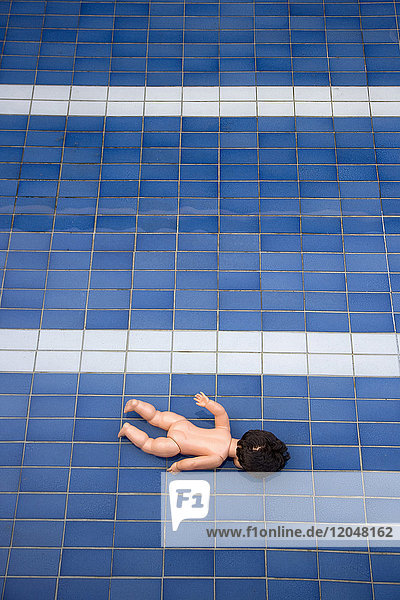 Doll in Empty Pool