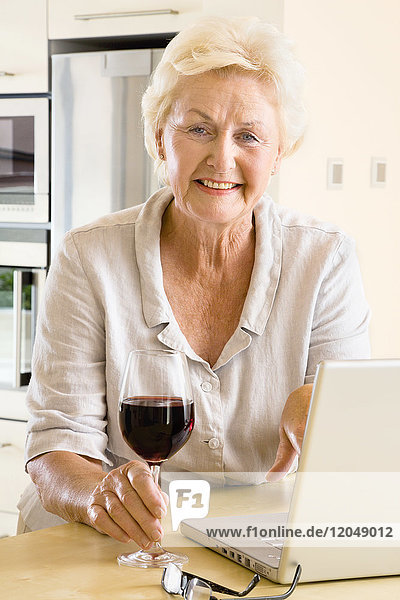 Portrait of Woman with Wine and Laptop Computer