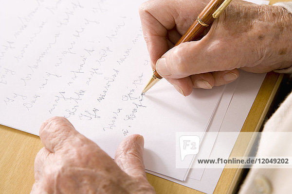Woman's Hands Writing Letter