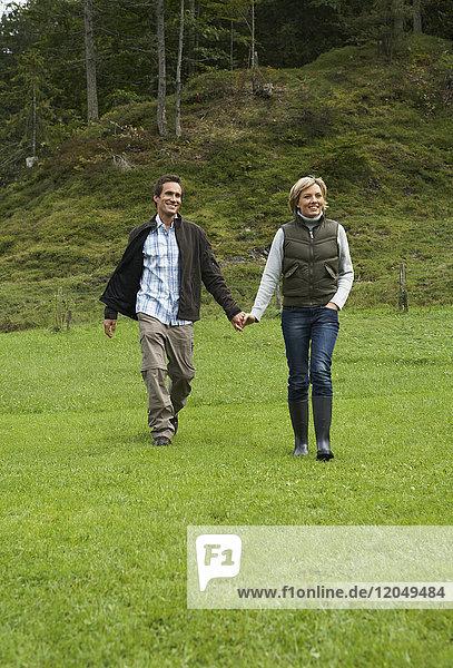 Couple Walking in Field