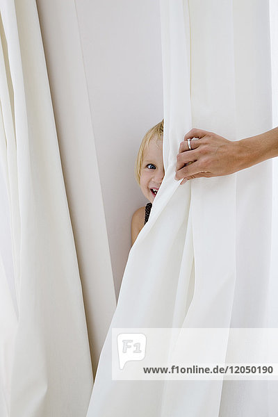 Little Girl Playing Hide and Seek