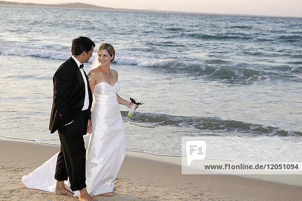Married Couple Walking along Beach  Noosa Beach  Australia