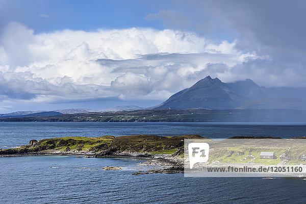 Scottish coast with dramatic cloud formations on the Isle of Skye in Scotland  United Kingdom
