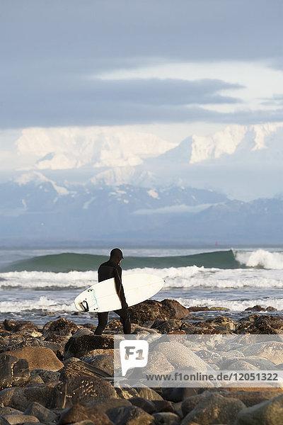 Surfer On The Beach Near Yakutat  Southeast Alaska  USA