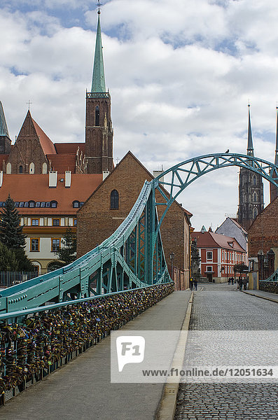 Tumski Bridge And Lovers Locks With Spires Of Cathedral In The Background; Wroclaw  Lower Silesia  Poland