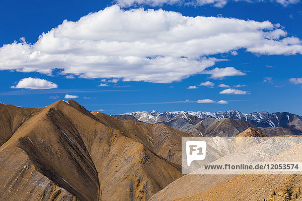Clouds hover over endless bare  rugged mountain ridges in the Polychrome Mountain backcountry unit of Denali National Park; Alaska  United States of America