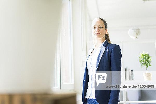 Portrait of confident businesswoman at the window