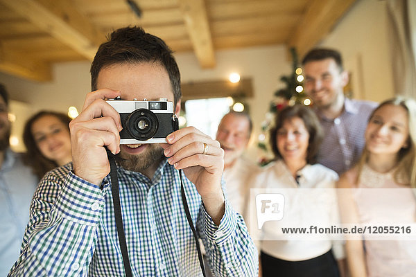 Photographer with family at home at Christmas